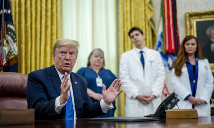 President Donald Trump talks to journalists after signing a proclamation honoring National Nurses Day in the Oval Office at the White House in Washington on May 6, 2020. (Doug Mills-Pool/Getty Images)