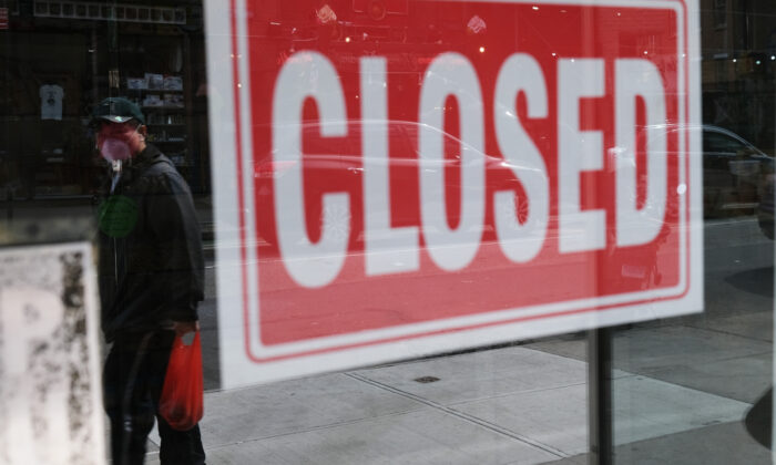 A store stands closed in New York City on April 21, 2020. (Spencer Platt/Getty Images)
