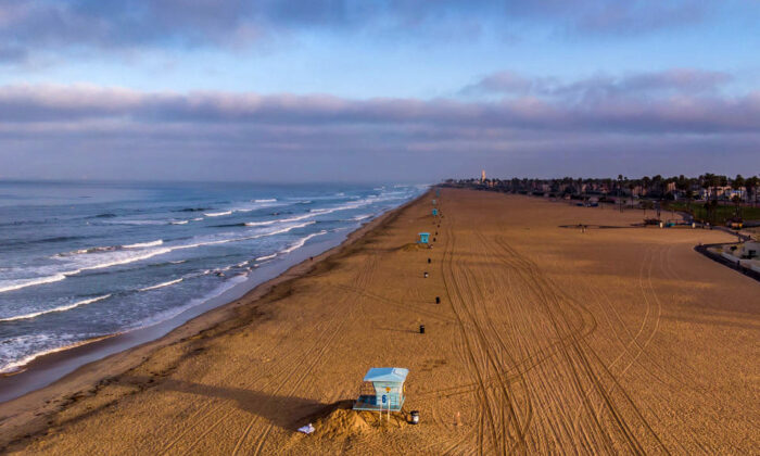 An aerial view shows an empty beach in Huntington Beach, Calif., on May 02, 2020. State officials reopened the last of the county's beaches for active use on May 7.  (Apu Gomes/AFP via Getty Images)