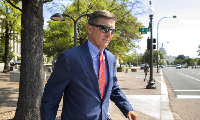 Lt. Gen. Michael Flynn, President Donald Trump's former national security adviser, leaves the federal court following a status conference with Judge Emmet Sullivan, in Washington, on Sept. 10, 2019. (Manuel Balce Ceneta/AP Photo)