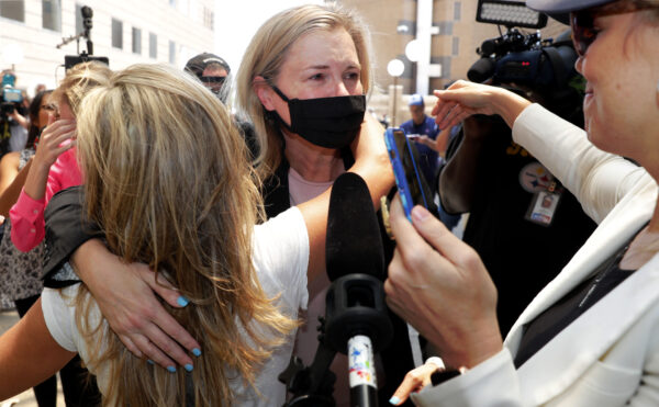 Salon owner Shelley Luther hugs supporters