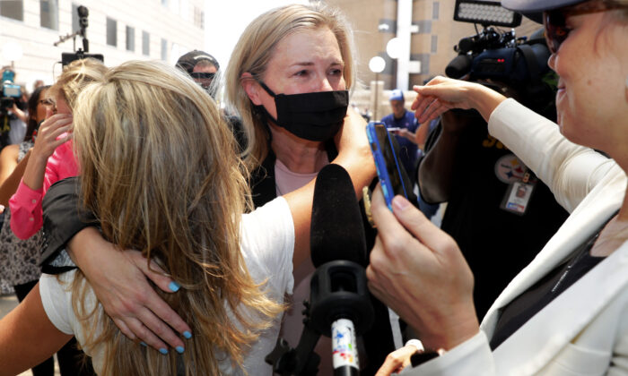 Salon owner Shelley Luther hugs supporters after she was released from jail in Dallas, Texas, on May 7, 2020. (LM Otero/AP)