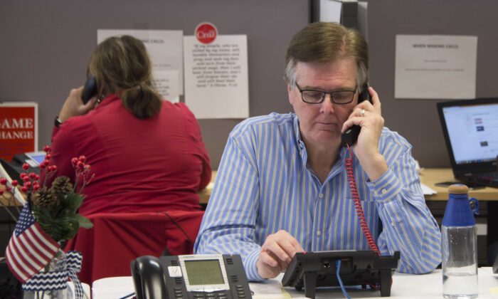 Texas Lt. Gov. Dan Patrick speaks on the phone in a file photograph. (Jim Watson/AFP via Getty Images)