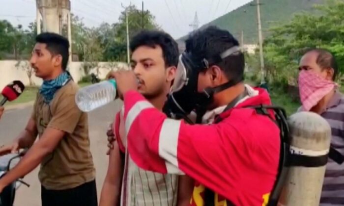 A rescue official helps a victim drink water following a gas leak at the LG Polymers Plant Building in Visakhapatnam, Andhra Pradesh, India, on May 7, 2020. (ANI/via Reuters)