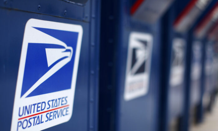 U.S. Postal Service mail boxes at a post office in Encinitas, California, in a 2013 file photograph. (Mike Blake/Reuters)