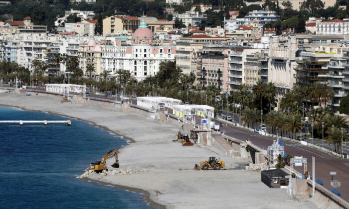 Construction machineries in action on the deserted beach of the Promenade des Anglais in Nice, France, on May 7, 2020. (REUTERS/Eric Gaillard)