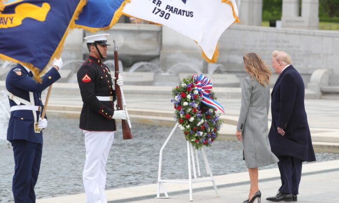 U.S. President Donald Trump and First Lady Melania Trump stand in front of a wreath during a Victory in Europe Day 75th anniversary ceremony at the World War II Memorial in Washington, on May 8, 2020. (Tom Brenner/Reuters)