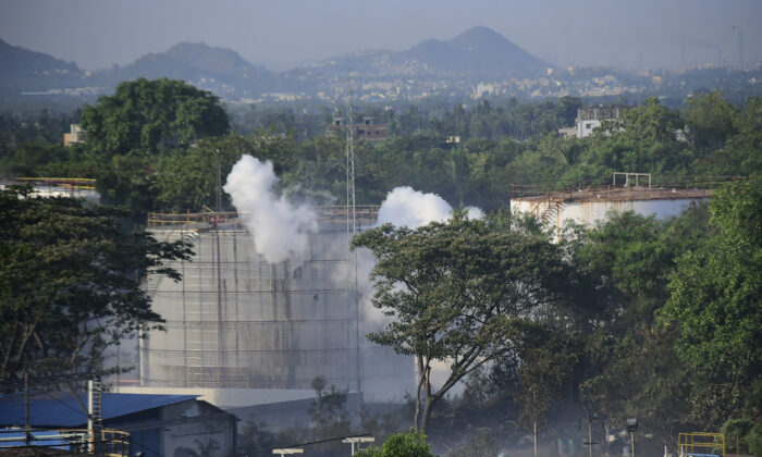 Smoke rises from LG Polymers plant, the site of a chemical gas leakage, in Vishakhapatnam, India, on May 7, 2020. (AP Photo)