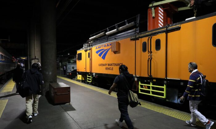 Passengers disembark a train at Union Station in Washington on April 9, 2020. (Rob Carr/Getty Images)
