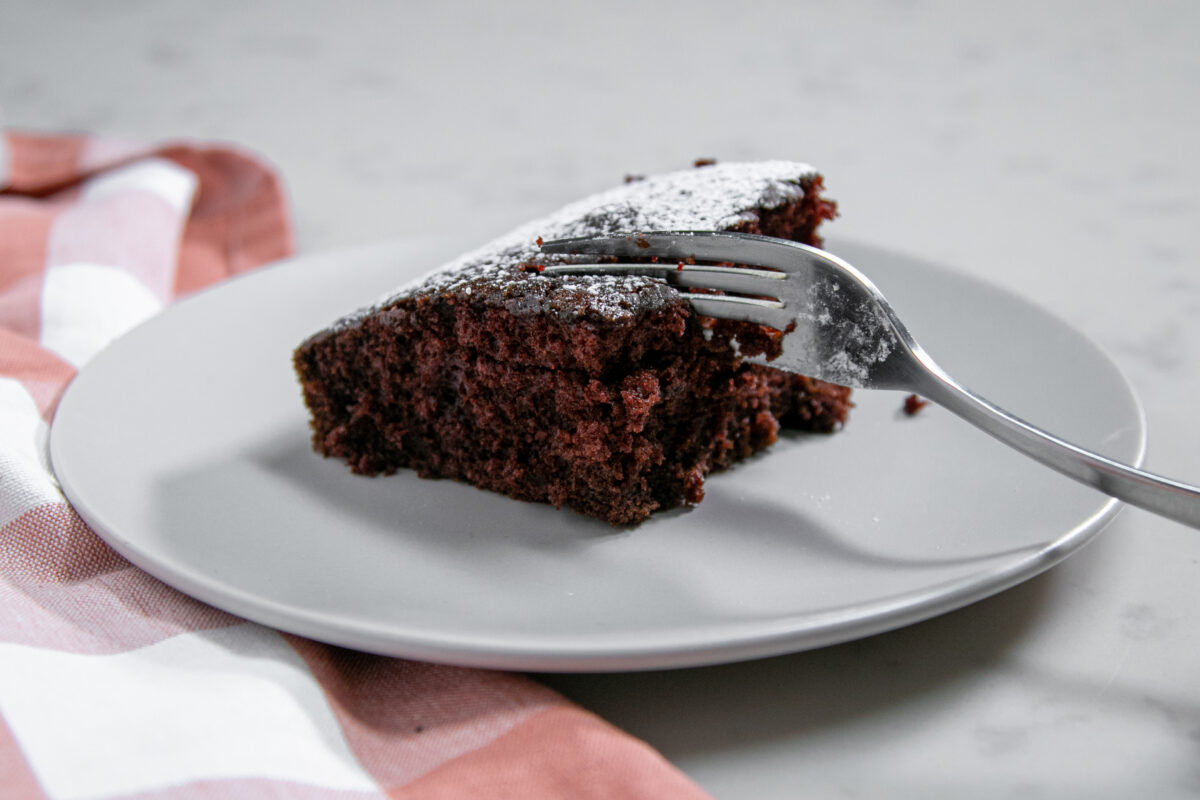 chocolate crazy cake with powdered sugar on plate 2