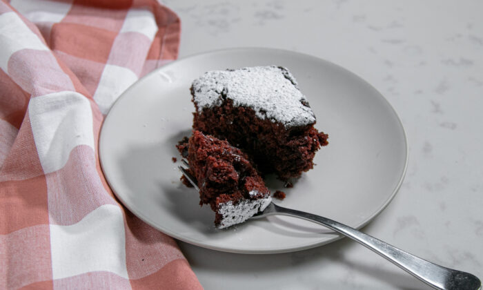 The recipe makes a tender, chocolate-y cake, with coveted edge pieces that chew almost like a cake-meets-brownie. (Chung I Ho/The Epoch Times)
