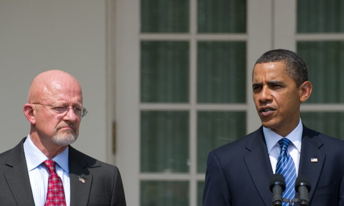 President Barack Obama speaks alongside retired General James Clapper, Obama's nominee for director of national intelligence, during the announcement in the Rose Garden of the White House in Washington on June 5, 2010. (Saul Loeb/AFP/Getty Images)