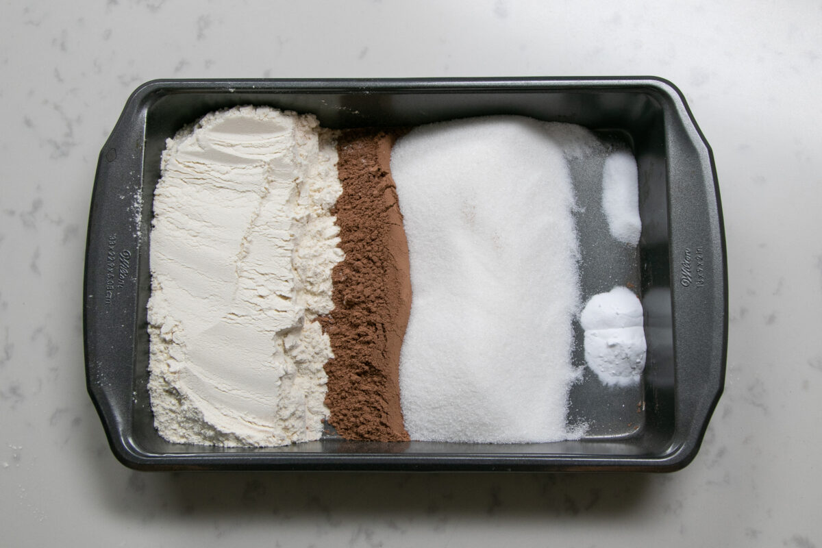 dry ingredients for chocolate crazy cake in pan