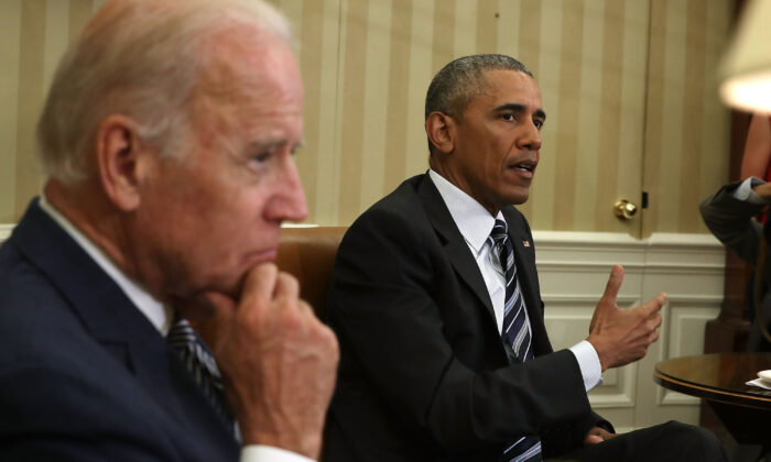 President Barack Obama speaks as Vice President Joe Biden listens during a White House meeting on June 13, 2016. (Alex Wong/Getty Images)