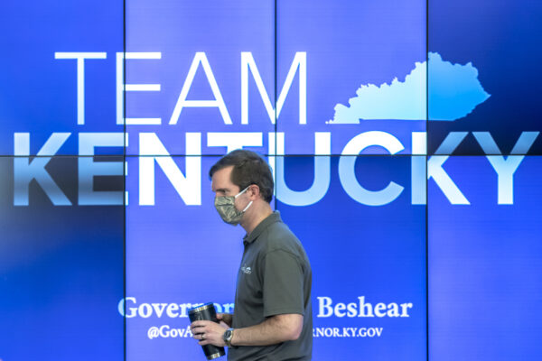Kentucky Gov. Andy Beshear walks to the podium during a media conference at the state's Emergency Operations Center