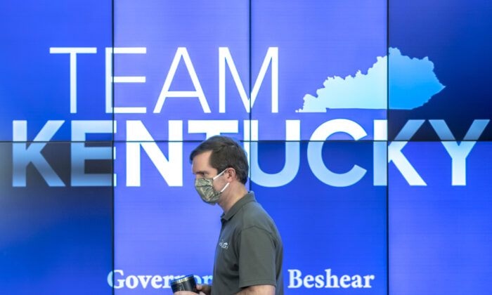 Kentucky Gov. Andy Beshear walks to the podium during a media conference at the state's Emergency Operations Center at the Boone National Guard Center in Frankfort, Ky., to provide an update on the novel coronavirus on May 3, 2020. (Ryan C. Hermens/Lexington Herald-Leader via AP)