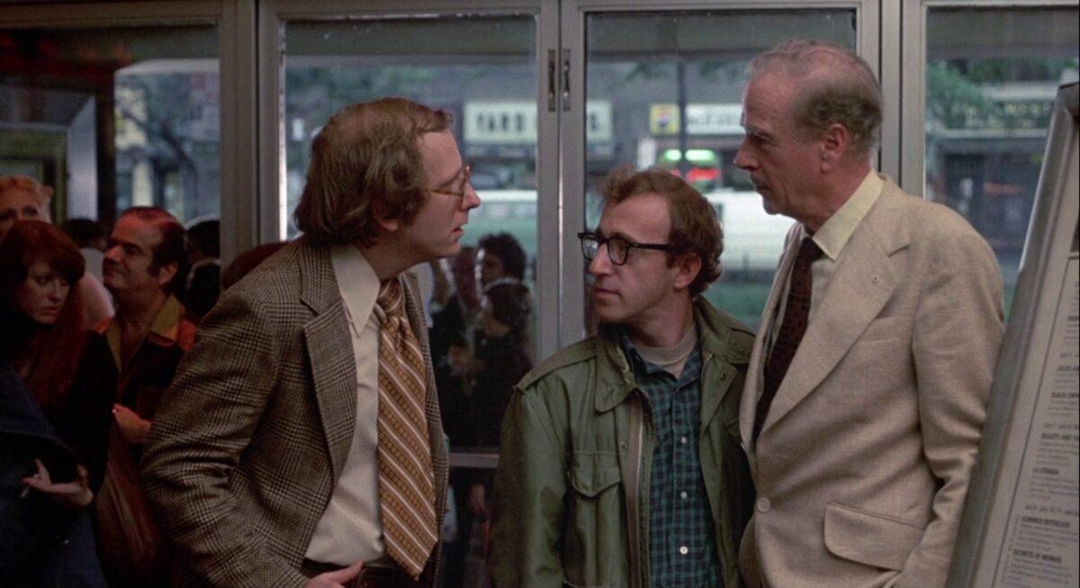 """3 men in a movie theater ticket line in """"Annie Hall"""""""