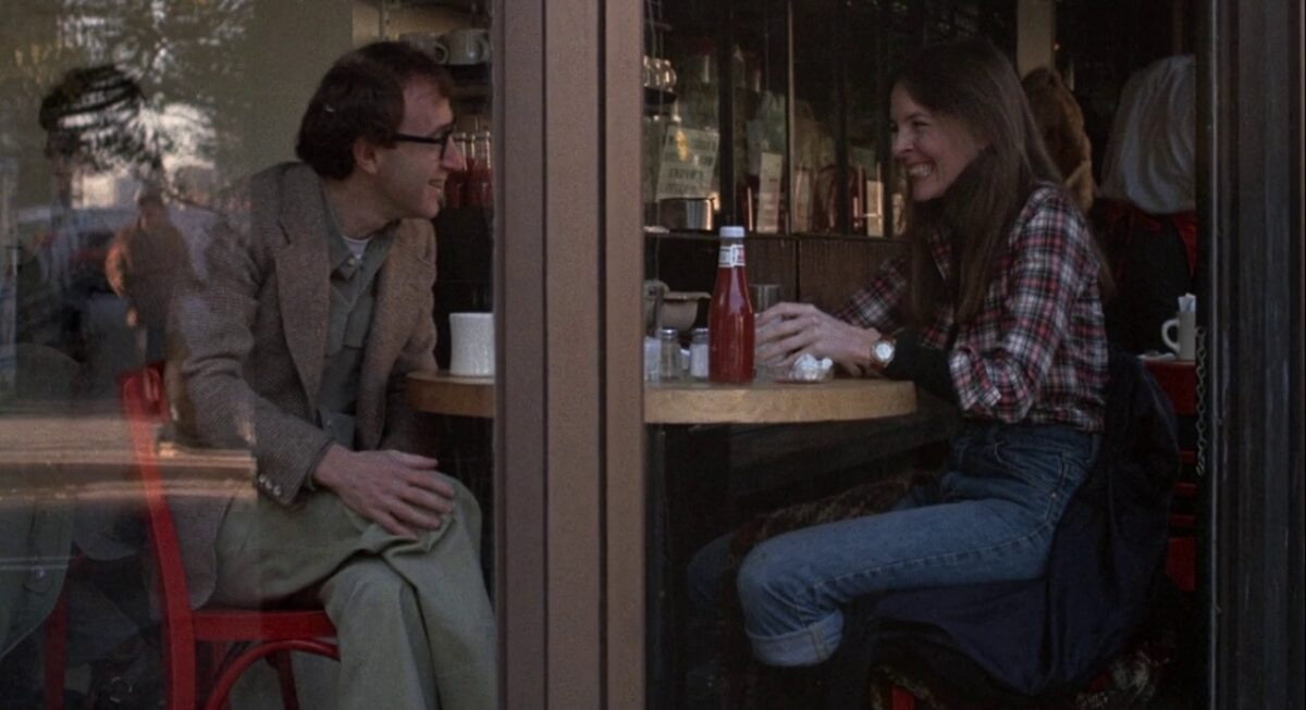"""man and woman seated in a restaurant in """"Annie Hall"""""""