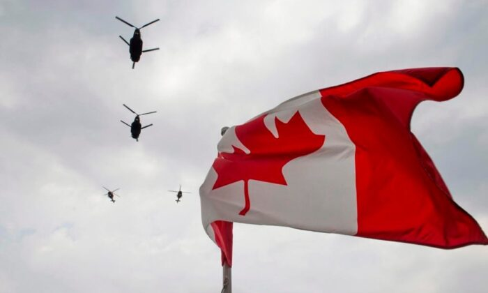 Canadian Forces CH-47 Chinook helicopters participate in a flyover of Parliament Hill in Ottawa, on May 9, 2014. (Justin Tang/The Canadian Press)
