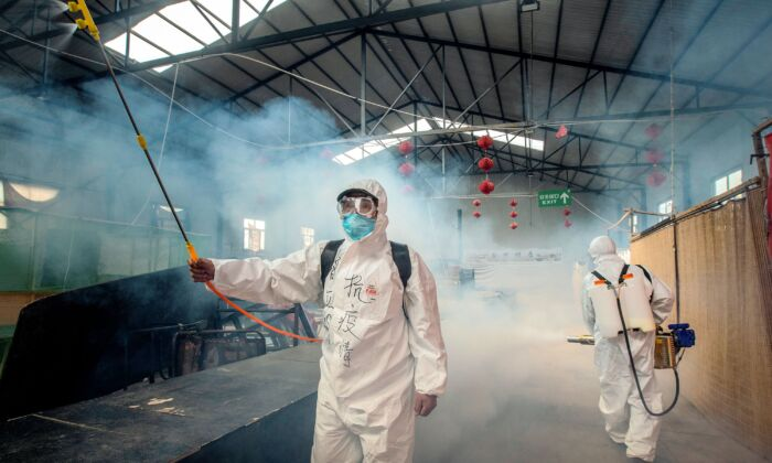 Staff are spraying disinfectant at a market in Suifenhe, Heilongjiang, China on May 6, 2020. (STR/AFP via Getty Images)