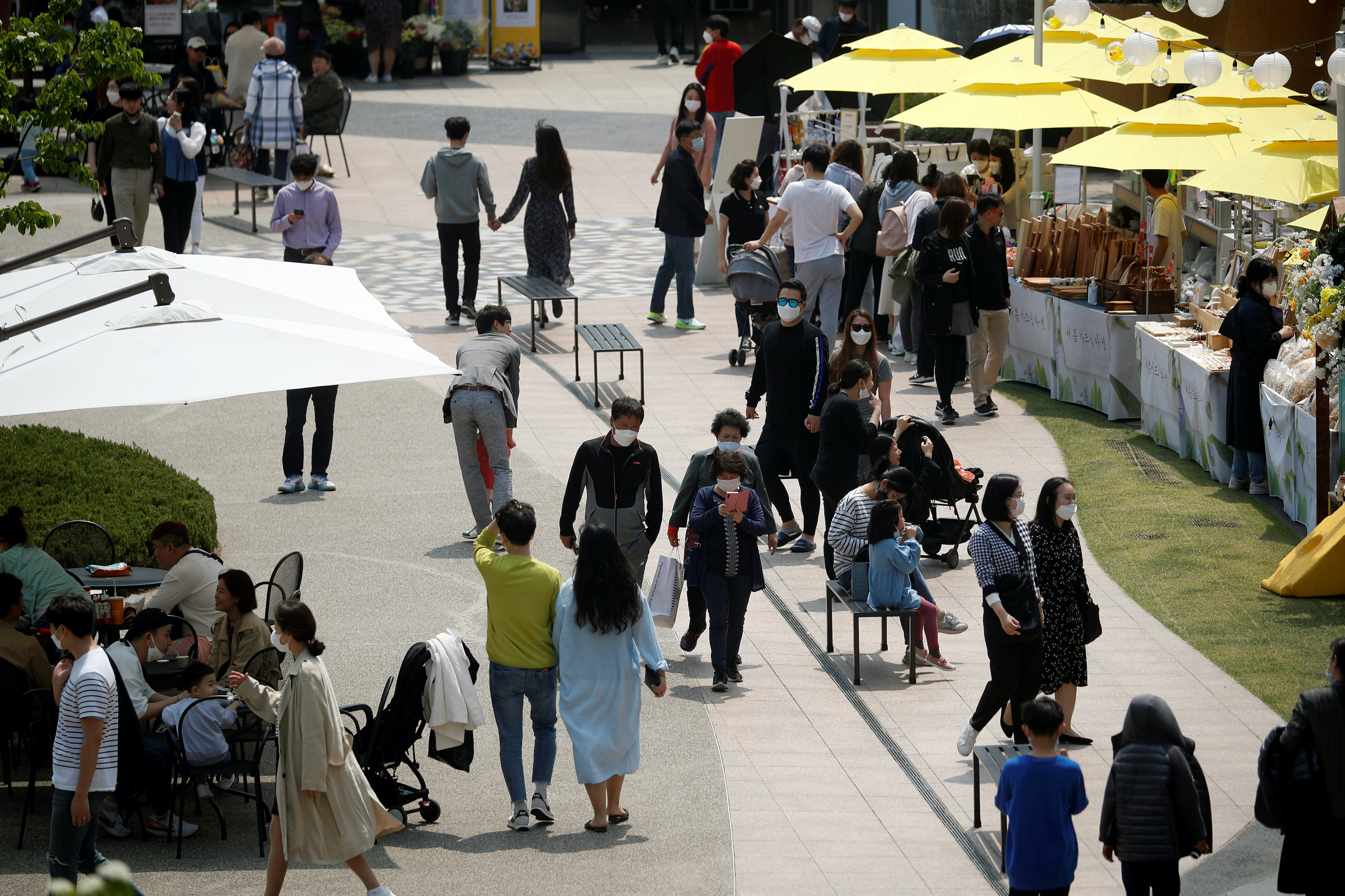 People wearing masks to avoid the spread of the coronavirus disease (COVID-19) shop at an outlet mall in Gimpo