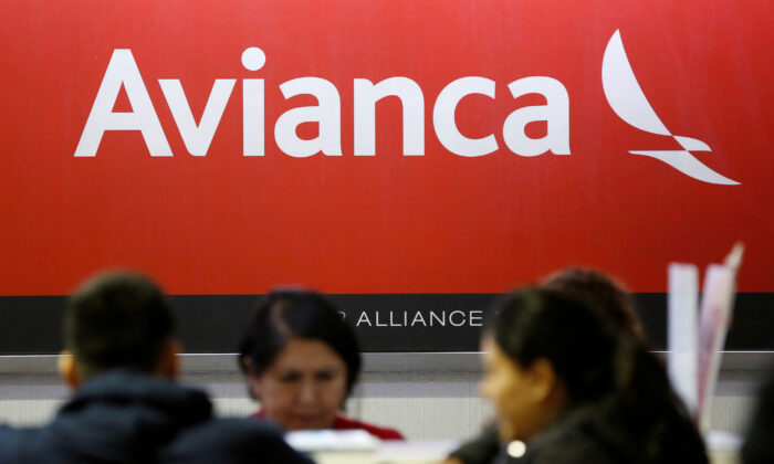 The logo of Avianca Airlines is pictured at a counter at the Benito Juarez International Airport in Mexico City, Mexico, on March 16, 2020. (Gustavo Graf/Reuters/File Photo)