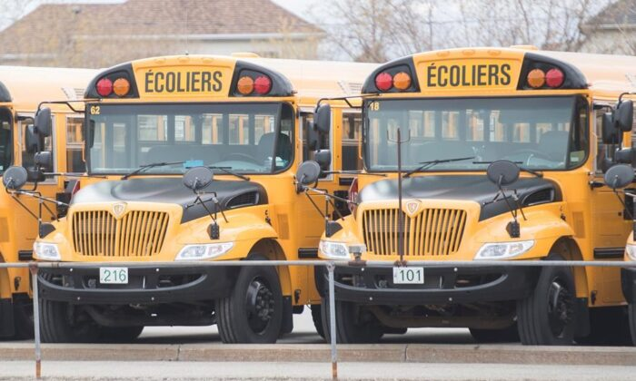School buses are shown at a depot in Vaudreuil-Dorion, Que., west of Montreal, on May 10, 2020. Quebec schoolchildren will be entering a vastly changed environment this week when they head back to classrooms that have been closed since mid-March because of COVID-19. (The Canadian Press/Graham Hughes)