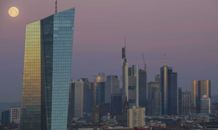 Office buildings, including the corporate headquarters of the European Central Bank (ECB), Commerzbank and Deutsche Bank stand in the financial district in the city center lit by the full moon and the sunrise in Frankfurt, Germany, on March 21, 2019. (Thomas Lohnes/Getty Images)
