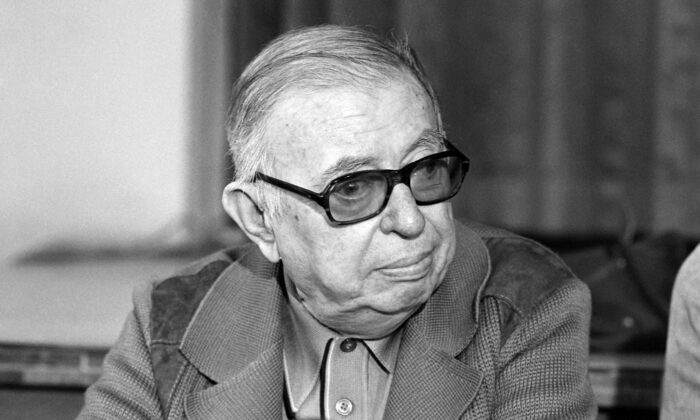 """Jean-Paul Sartre is seen during a press conference for the initiative called """"A Boat for Vietnam,"""" at the Lutetia Hotel in Paris on June 20, 1979. (Michel Clement/AFP via Getty Images)"""