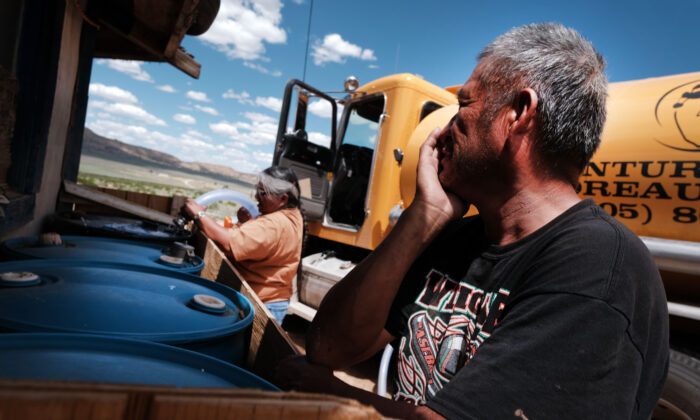 A member of the Navajo Nation receives a water delivery in the town of in Thoreau, New Mexico, on June 06, 2019. (Spencer Platt/Getty Images)