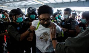 Hundreds Arrested as Hong Kong Protests Renew on Mother's Day