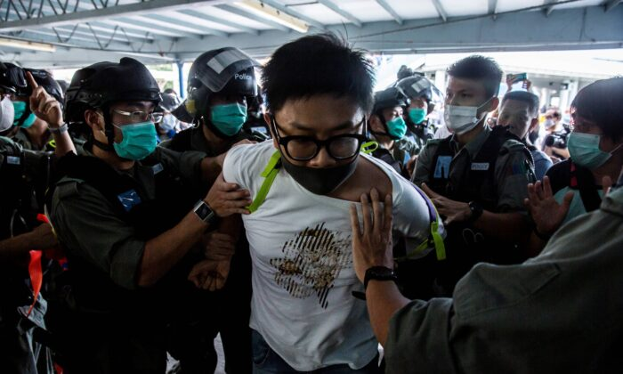 Police officers arrest a pro-democracy demonstrator (C) during a pro-democracy protest calling for the city's independence in Hong Kong on May 10, 2020. (Isaac Lawrence/AFP via Getty Images)