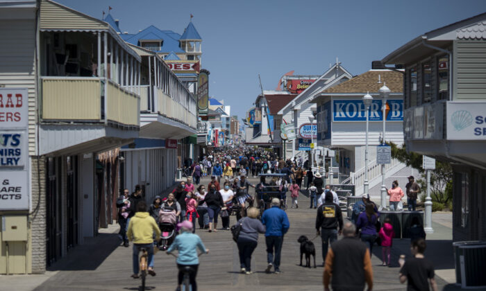 People walk on the boardwalk as the area reopens in Ocean City, Md., on May 10, 2020. (Eric Thayer/Getty Images)