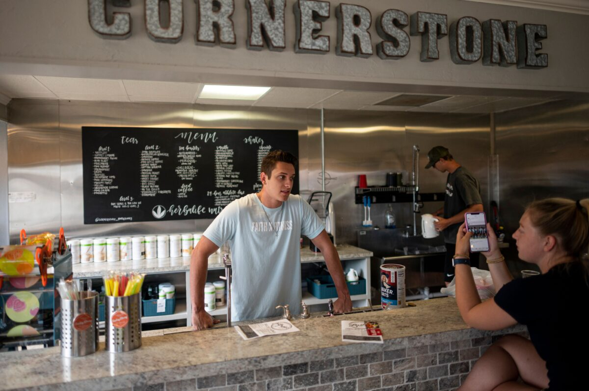 Dawson Padilla (L), owner of a protein shakes store