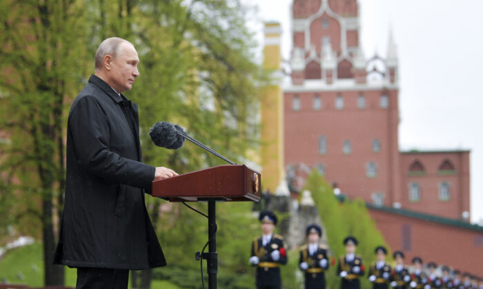 Russian President Vladimir Putin addresses the nation from the Tomb of the Unknown Soldier at the Kremlin wall marking the 75th anniversary of the Nazi defeat in World War II in Moscow, Russia on May 9, 2020. (Alexei Druzhinin, Sputnik, Kremlin Pool Photo via AP)