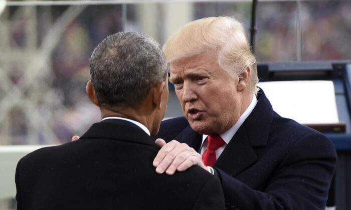 President Donald Trump speaks with former President Barack Obama during the Presidential Inauguration at the US Capitol in Washington on Jan. 20, 2017. (Saul Loeb - Pool/Getty Images)