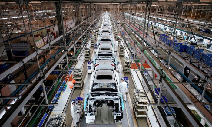 Employees work on a production line inside a Dongfeng Honda factory after lockdown measures in Wuhan, the capital of Hubei province and China's epicentre of the CCP virus outbreak, were further eased, on April 8, 2020. (Aly Song/REUTERS)