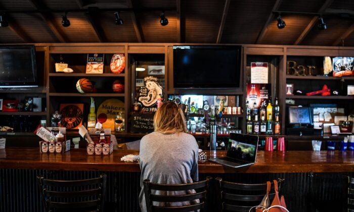 A customer sits at the bar to eat at Moe's Original BBQ restaurant amid the coronavirus pandemic in Atlanta, Ga., on April 27, 2020. (Chandan Khanna/AFP via Getty Images)