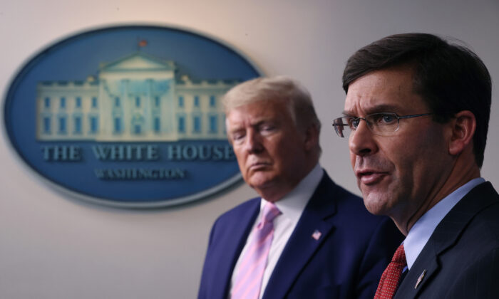 Secretary of Defense Mark Esper speaks as President Donald Trump listens during the daily White House coronavirus press briefing in Washington, on April 1, 2020. (Win McNamee/Getty Images)