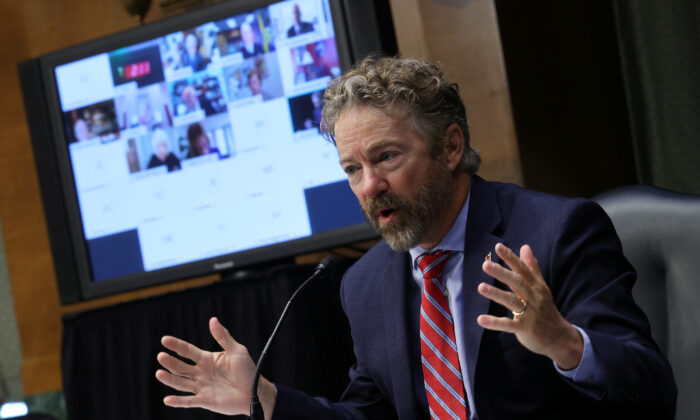 Sen. Rand Paul (R-Ky.) participates in the Senate Committee for Health, Education, Labor, and Pensions hearing on the COVID-19 response, in Washington on May 12, 2020. (Win McNamee/Reuters)