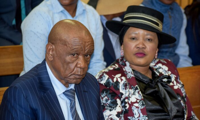 Prime Minister of Lesotho Tom Thabane (L) and his wife Maesaiah Thabane sit at the Magistrate Court in Maseru, Lesotho, on Feb. 24, 2020. (Mouse Molise/AFP via Getty Images)