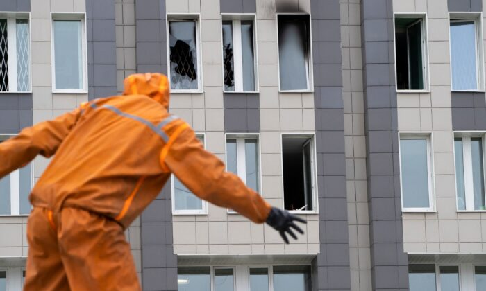 A Russian Emergency Situation worker attends the scene of a fire at St. George Hospital in St. Petersburg, Russia, on May 12, 2020. (Dmitry Lovetsky/AP Photo)