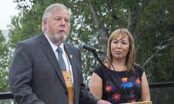 Robert Bertrand, national chief of the Congress of Aboriginal Peoples, addresses a news conference along with Francyne Joe, right, president of the Native Women's Association of Canada, at a meeting of Canadian premiers and Indigenous leaders at Le Pays de la Sagouine, a recreated historic Acadian village, in Bouctouche, N.B. on July 18, 2018. The Congress of Aboriginal Peoples has filed an application in the Federal Court of Canada, challenging the funding allocation of $250,000 it received as part of a COVID-19 fund earmarked for off-reserve Indigenous peoples. (Andrew Vaughan/The Canadian Press)
