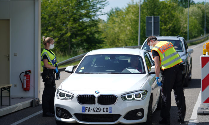 German border police officers stop cars in a checkpoint of the D87 road at the German-French border during the CCP virus crisis near Rastatt, Germany, on May 8, 2020.  (Thomas Niedermueller/Getty Images)
