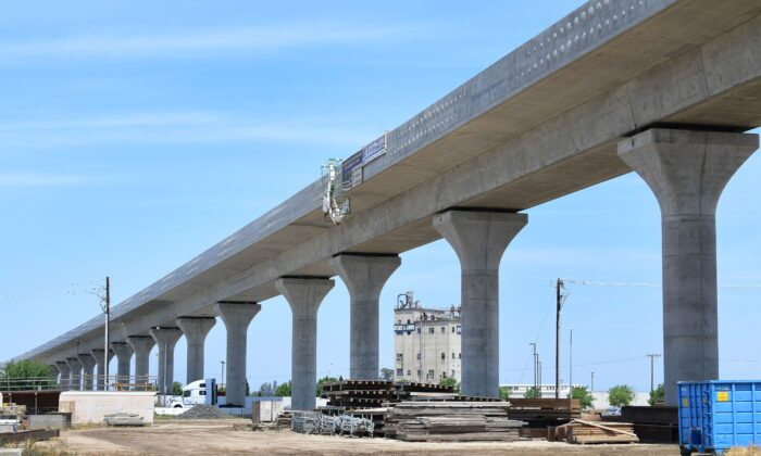 A truck crosses beneath the ongoing contruction of the high-speed railway in Fresno, California, on May 8, 2019. (Frederic J. Brown/AFP via Getty Images)