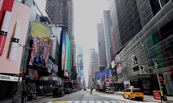 An almost empty street at Times Square in Manhattan in New York City on March 16, 2020. (Johannes Eisele/AFP via Getty Images)