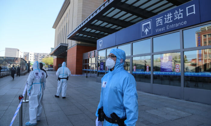 Police officers stand guard outside Jilin city's railway station which is closed due to the CCP virus outbreak in Jilin, China on May 13, 2020. (STR/AFP via Getty Images)