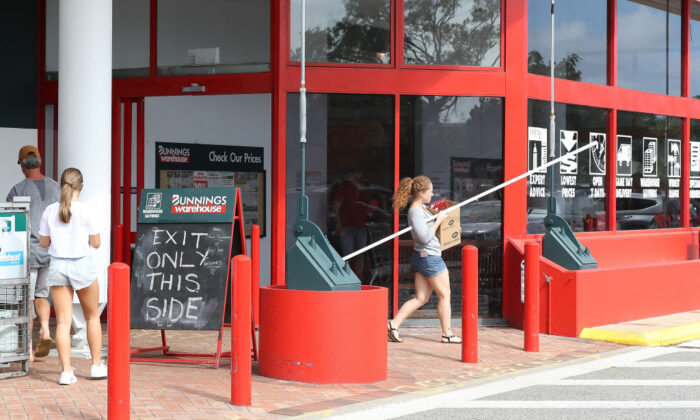 Exit signage is seen outside the Bunnings O'Connor store due to new government social distancing measures on March 28, 2020 in Perth, Australia.  (Photo by Paul Kane/Getty Images)