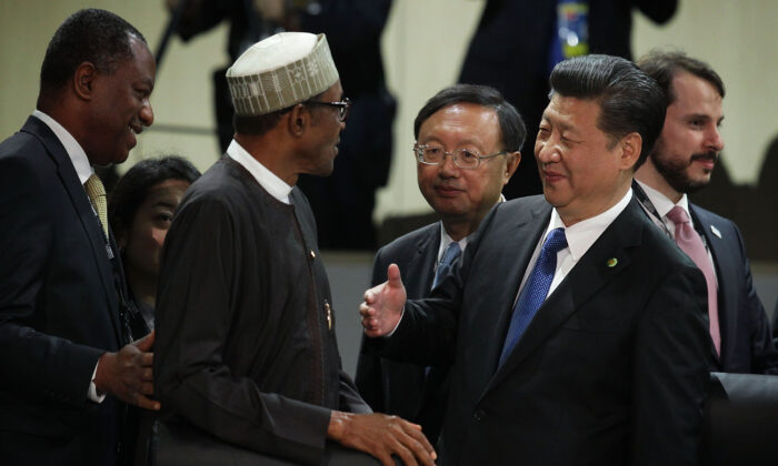 Chinese leader Xi Jinping (R) greets President of Nigeria Muhammadu Buhari (L) during a plenary session of the 2016 Nuclear Security Summit in Washington on April 1, 2016. (Alex Wong/Getty Images)