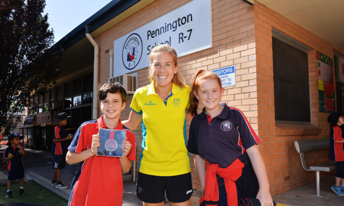 Jess Trengove welcomed by students Jamie Phillips and Caitlin Mitchell during the Commonwealth Games Schools Assembly at Pennington Primary School on February 14, 2018 in Adelaide, Australia.  (Mark Brake/Getty Images)